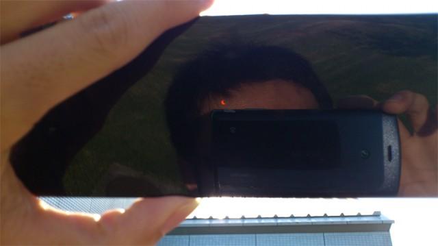日食を写す男